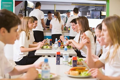 Teens Eating In School Cafeteria